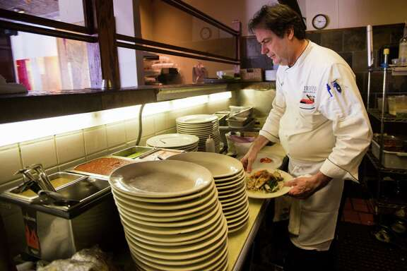 John Watt is the executive chef and proprietor of Prego, a neighborhood Italian restaurant, prepares swordfish with clams, roasted garlic and roasted peppers. Wednesday, June 10, 2015, in Houston.