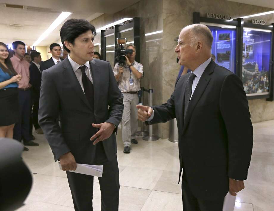Calif., Senate President Pro Tem Kevin de Leon, D-Los Angeles, left, and Calif., Gov. Jerry Brown talk for a moment after a news conference where they unveiled a budget agreement, at the Capitol in Sacramento, Calif., Tuesday, June 16, 2015. The budget plan sends billions more to public schools and universities in the fiscal year that begins July 1. (AP Photo/Rich Pedroncelli) Photo: Rich Pedroncelli, Associated Press
