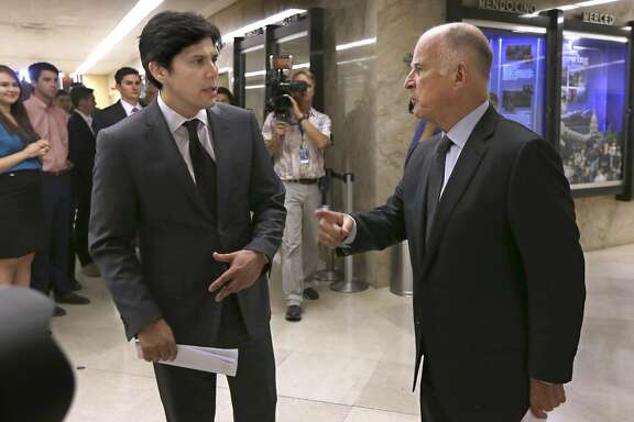 Calif., Senate President Pro Tem Kevin de Leon, D-Los Angeles, left, and Calif., Gov. Jerry Brown talk for a moment after a news conference where they unveiled a budget agreement, at the Capitol in Sacramento, Calif., Tuesday, June 16, 2015. The budget plan sends billions more to public schools and universities in the fiscal year that begins July 1. (AP Photo/Rich Pedroncelli)