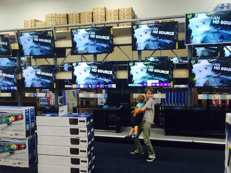 Browsing the TVs at Best Buy