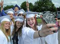 Miranda Brantner, right, snaps a photo of herself with her class mates Kassie Mendes, Austin Nable, Nicole Pacheco, Carly Hewes, Jackie Lesica and Carlos Paulino before they head into the 2015 Danbury High School Commencement Exercises on Wednesday night, June 17, 2015, at Danbury High School, Danbury, Conn.