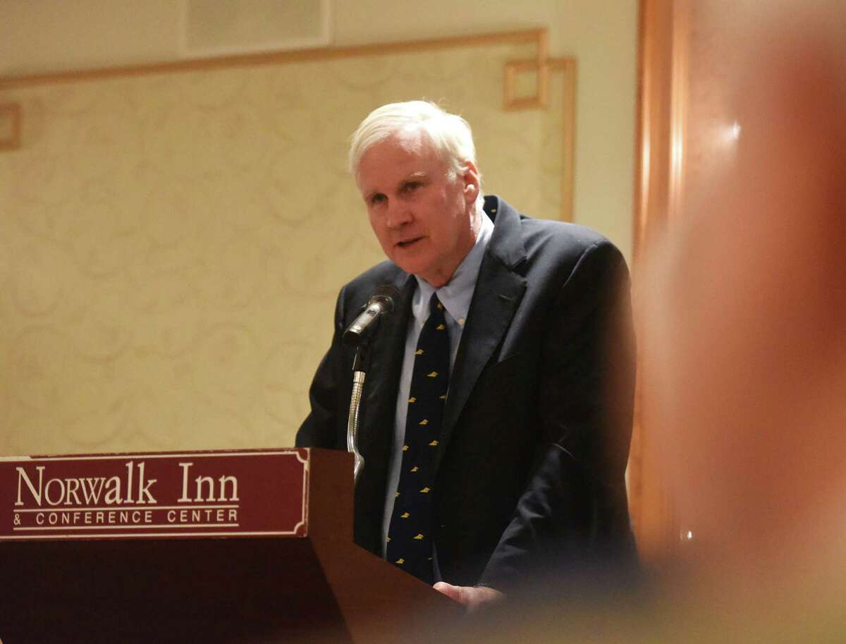 Westhill swimming coach Rick Lewis speaks after being inducted into the FCIAC Hall of Fame at the league's annual banquet at the Norwalk Inn in on Tuesday.