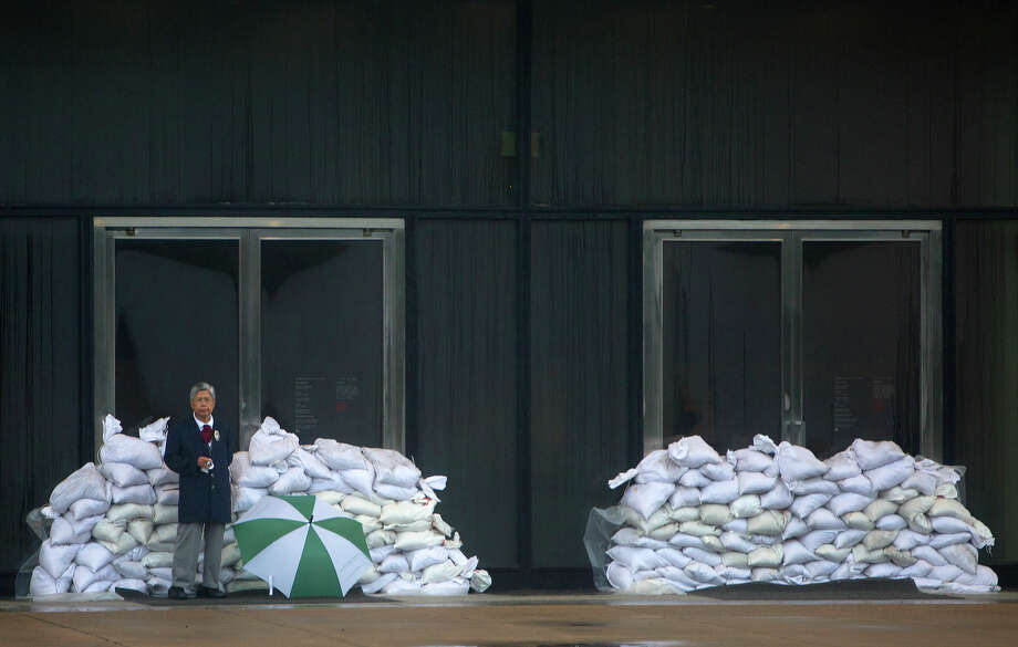 A security guard at the Museum of Fine Arts, Houston stands in front of sandbags that were set up as a precaution against flooding. (Cody Duty / Houston Chronicle) Photo: Cody Duty, Staff / Â 2015 Houston Chronicle