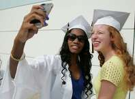 Scheba Derogene and Ali Hardisty, both of Easton, snap an iPhone photo prior to the 2015 Joel Barlow High School commencement ceremony at the William A. O'Neill Center, Western Connecticut State University in Danbury, Conn. on Wednesday, June 17, 2015.
