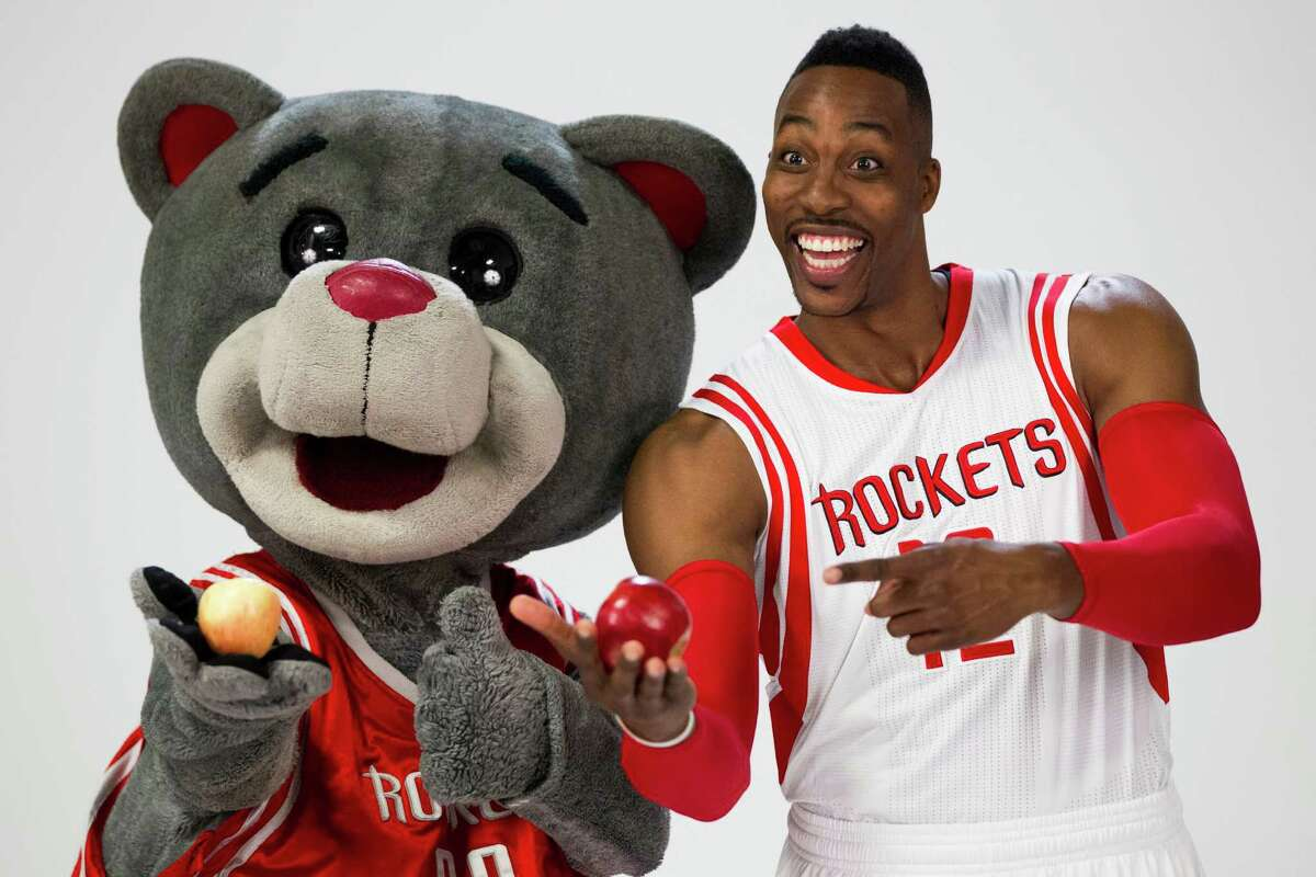 Houston Rockets mascot Clutch, left, poses for a photo with center Dwight Howard during Rockets media day at Toyota Center Monday, Sept. 29, 2014, in Houston. ( Brett Coomer / Houston Chronicle )