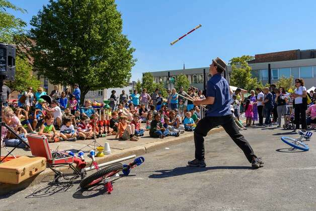 """The Incredible Larry"" Larry Rundle delights a crowd at the Schenectady Kids Arts Festival on Saturday."