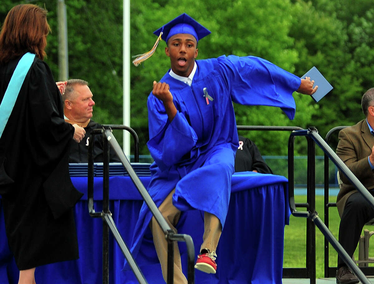 Graduate Tyree Coverson dances after getting his diploma, during Seymour High School's 128th Annual Commencement in Seymour, Conn., on Wednesday June 17, 2015.