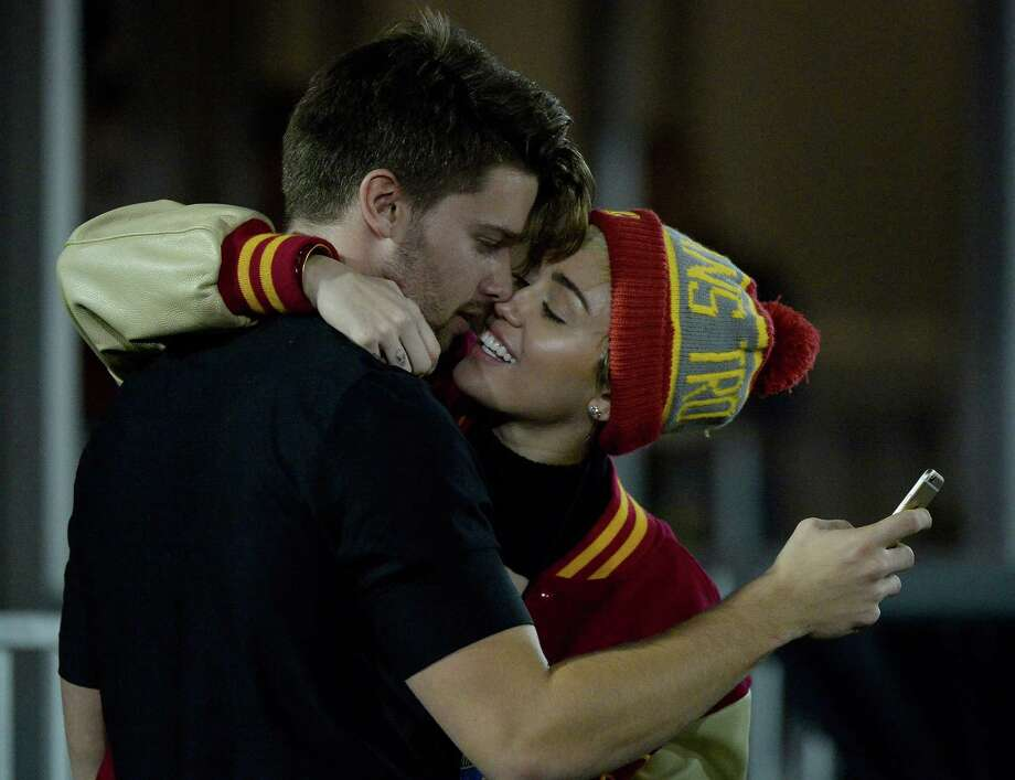 But Patrick Schwarzenegger must have been texting his mom during a game between the California Golden Bears and the USC Trojans ... or maybe checking his stocks? You know, something very important. Photo: Harry How, Getty Images / 2014 Getty Images