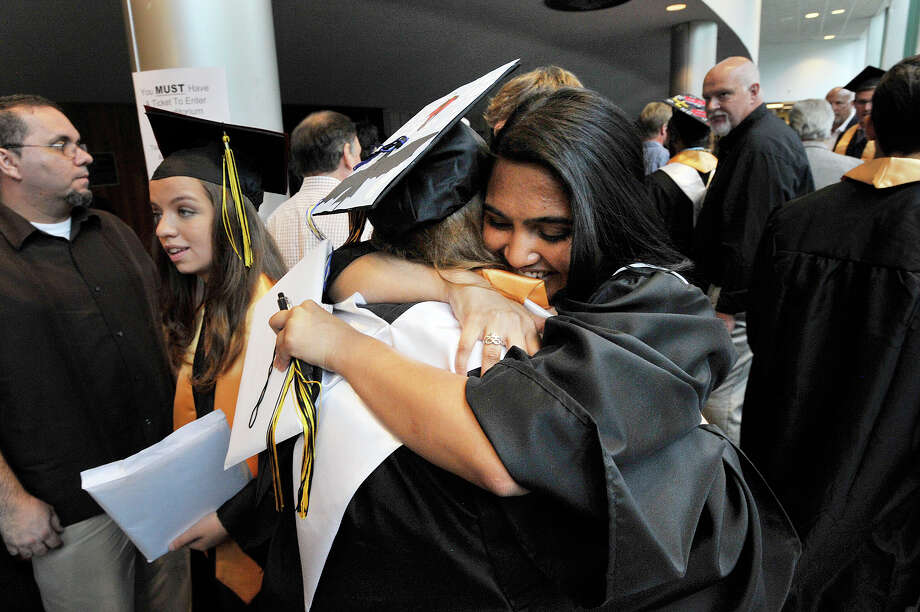 Priya Gada, right, and Bridget Smith embrace following the Academy of Information Technology and Engineering graduation ceremony at Rippowam Middle School in Stamford, Conn., on Wednesday, June 17, 2015. Photo: Jason Rearick, Hearst Connecticut Media / Stamford Advocate