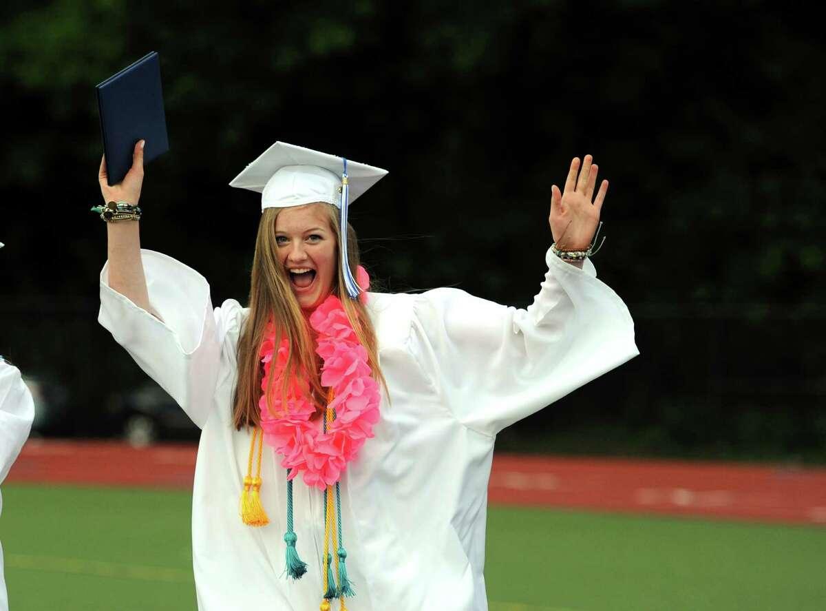 Graduate Caroline Yates celebrates during the Fairfield Ludlowe High School commencement ceremony Wednesday, June 17, 2015 on the school's Taft Field.