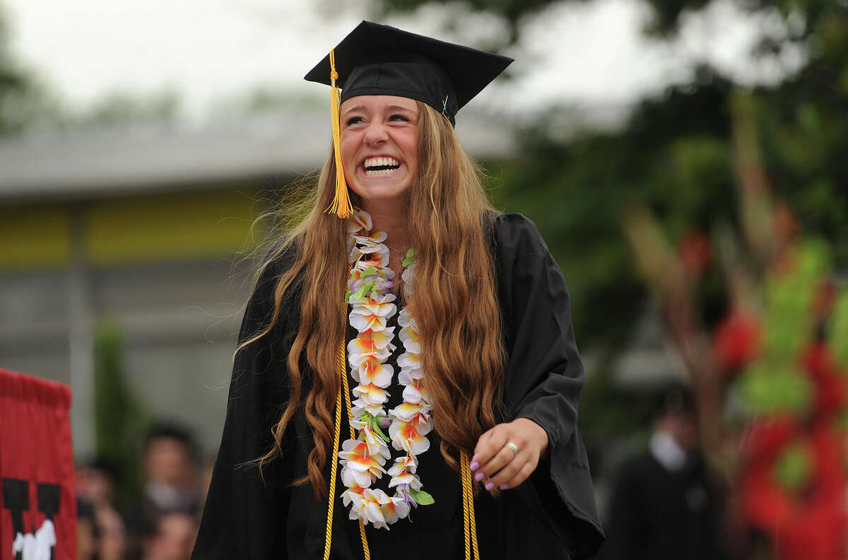 Graduate Julia Ridgeway is all smiles as she walks to receive her diploma during the Fairfield Warde High School graduation in Fairfield, Conn. on Wednesday, June 17, 2015.