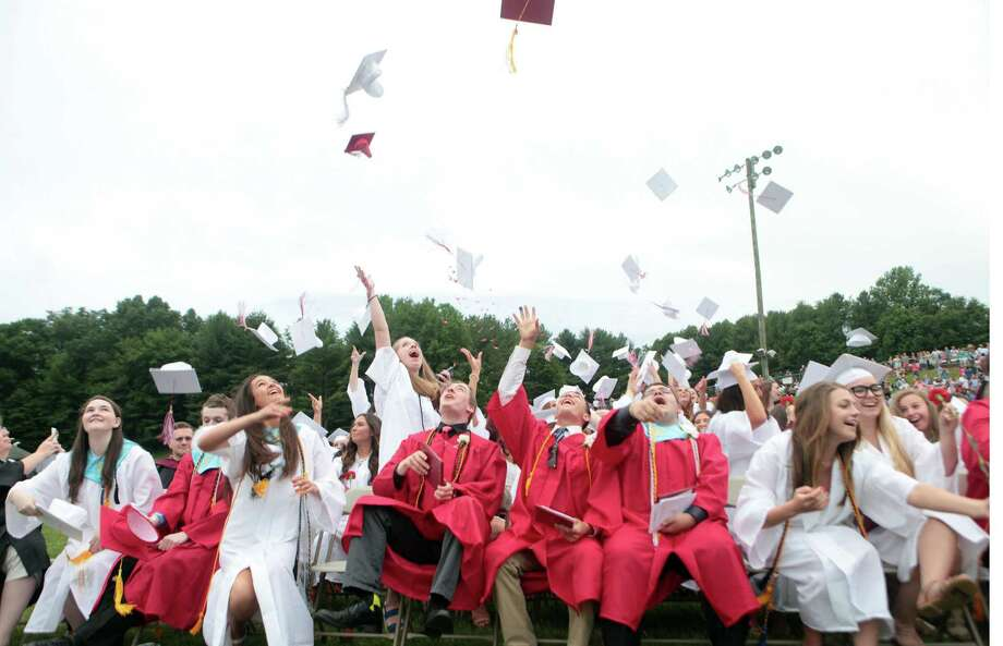 Masuk High School  graduates celebrate during commencement exercises in Monroe, Conn. on Wednesday, June 17, 2015. Photo: BK Angeletti, Hearst Connecticut Media / Connecticut Post freelance B.K. Angeletti
