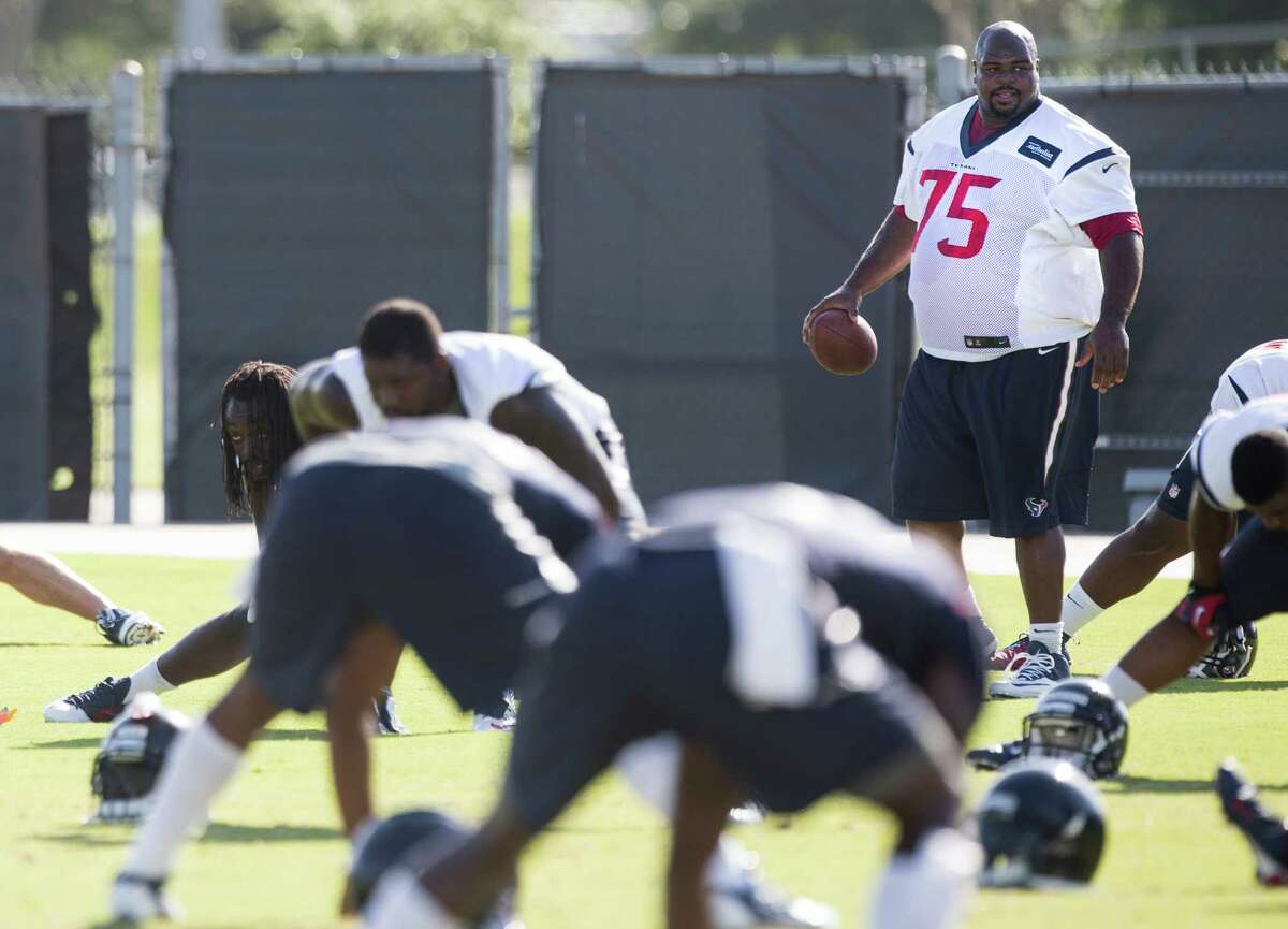 After visiting the Patriots last week to receive his second Super Bowl ring, nose tackle Vince Wilfork (75) is beginning the process of fitting in with the Texans at this week's minicamp.