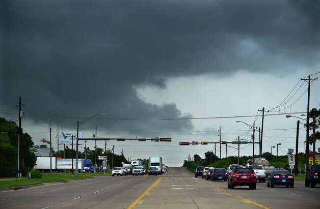 Ominous low-hanging clouds accompanied a thunderstorm from the outer bands of Tropical Storm Bill that was already reaching north Texas as this cell passed over East University Drive Tuesday, June 16, 2015, in Denton, Texas. (Al Key /The Denton Record-Chronicle via AP) ORG XMIT: TXDER103 Photo: Al Key / The Denton Record-Chronicle