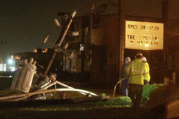 Center Point crews work to restore power after a power line fell on Highway 60 due to high winds from Tropical Storm Bill on Tuesday, June 16, 2015, in Wharton, Texas. (AP Photo/Patric Schneider)  ORG XMIT: TXPX109 Photo: Patric Schneider / FR170473 AP