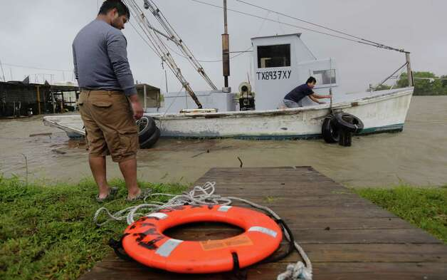 Oyster fishermen try to secure their boat as Tropical Storm Bill makes landfall, Tuesday, June 16, 2015, in Port Lavaca, Texas. (AP Photo/Eric Gay) ORG XMIT: TXEG109 Photo: Eric Gay / AP
