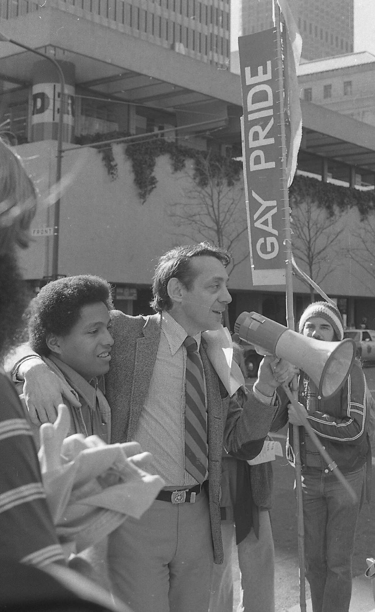 Harvey Milk speaks at a protest of a Canadian boycott of the magazine 'Body Politic' in front of the Alcoa building on Clay St. in San Francisco. 01/25/1978