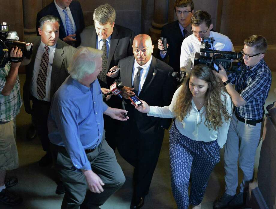 Assembly speaker Carl Hastie, center, is beset by reporters following his meeting with Gov. Cuomo Wednesday June 17, 2015 at the Capitol in Albany, NY. (John Carl D'Annibale / Times Union) Photo: John Carl D'Annibale / 00032313A