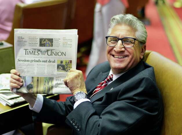 Assemblyman James Tedisco poses playfully with today's Times Union in the Assembly Chamber as the session winds down for the year Wednesday June 17, 2015 at the Capitol in Albany, NY. (John Carl D'Annibale / Times Union) Photo: John Carl D'Annibale / 00032313A