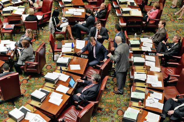 Activity on the floor of the state senate Wednesday June 17, 2015 at the Capitol in Albany, NY. (John Carl D'Annibale / Times Union) Photo: John Carl D'Annibale / 00032313A