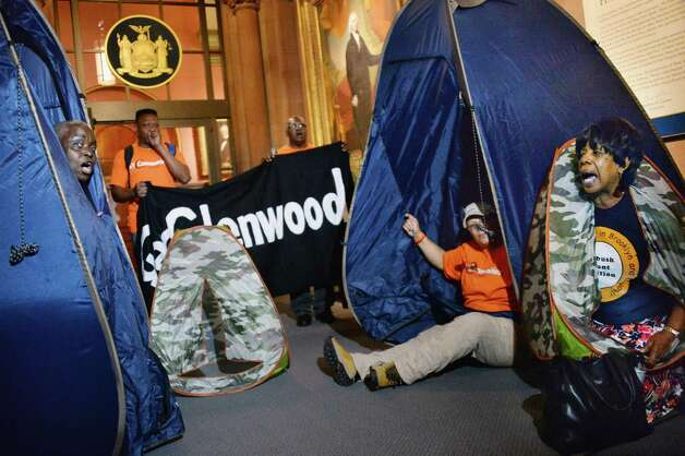 Rent control advocates demonstrate in front of Gov. Cuomo's offices Wednesday June 17, 2015 at the Capitol in Albany, NY. (John Carl D'Annibale / Times Union) Photo: John Carl D'Annibale / 00032313A