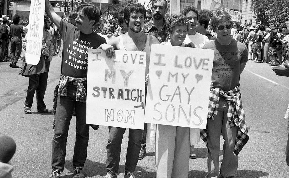 June 26, 1977: A mother marches with her gay sons during the 1977 Gay Freedom Day Parade in San Francisco. Photo: Vincent Maggiora, The Chronicle