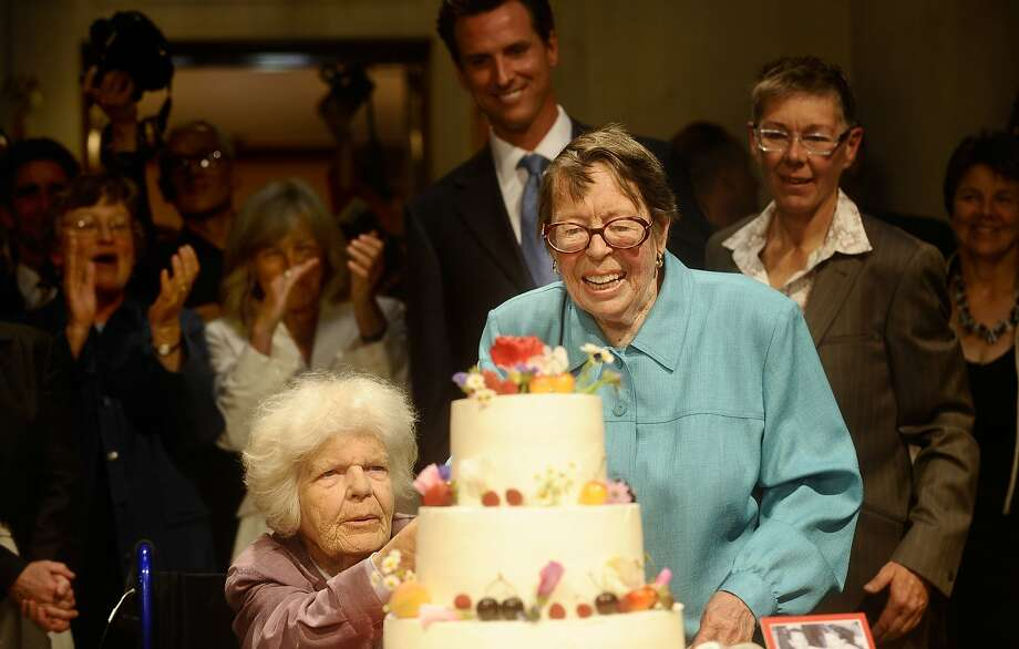 Phyllis Lyon, right, and Del Martin cut their wedding cake as Mayor Gavin Newsom watches on Monday, June 16, 2008, in San Francisco. Photo: Noah Berger, Special To The Chronicle