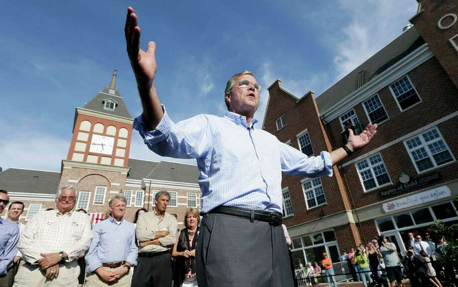 Republican presidential candidate Jeb Bush speaks to local residents during a town hall meeting, Wednesday, June 17, 2015, in Pella, Iowa. (AP Photo/Charlie Neibergall) Photo: Charlie Neibergall / Associated Press / AP