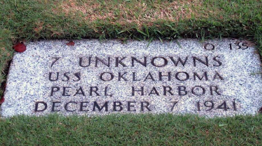 This stone identifies the grave of seven unknowns from the USS Oklahoma. Photo: Associated Press /File Photo / ap