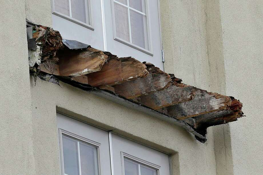 Officials suspect the balcony wood  was damaged by moisture after not being properly sealed . The investigation is still underway. Photo: Jeff Chiu / Associated Press / AP