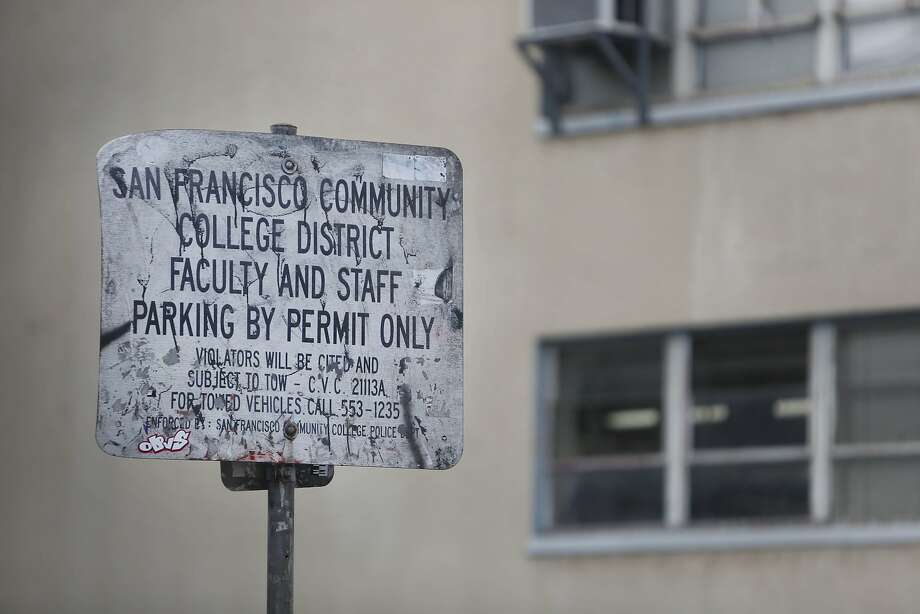 A well worn sign for City College district faculty and staff parking is seen at 33 Gough Street on Monday, January 12, 2014 in San Francisco, Calif. Photo: Lea Suzuki, The Chronicle