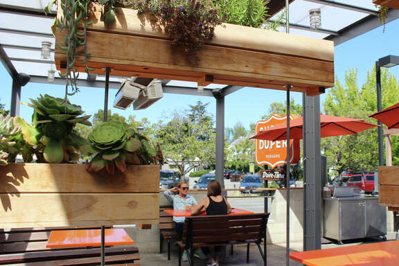 Super Duper Burgers in Mill Valley, above, features a front patio lined with succulents..