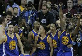 Golden State Warriors' Klay Thompson, left, Stephen Curry, Shaun Livingston, and Draymond Green celebrate after Game 6 of The NBA Finals between the Golden State Warriors and Cleveland Cavaliers at The Quicken Loans Arena on Tuesday, June 16, 2015 in Cleveland, Ohio. The Golden State Warriors defeated the Cleveland Cavaliers 105 to 97 to win the NBA Finals four games to two.