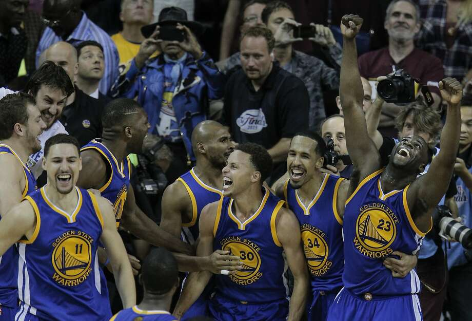 Golden State Warriors' Klay Thompson, left, Stephen Curry, Shaun Livingston, and Draymond Green celebrate after Game 6 of The NBA Finals between the Golden State Warriors and Cleveland Cavaliers at The Quicken Loans Arena on Tuesday, June 16, 2015 in Cleveland, Ohio. The Golden State Warriors defeated the Cleveland Cavaliers 105 to 97 to win the NBA Finals four games to two. Photo: Carlos Avila Gonzalez, The Chronicle