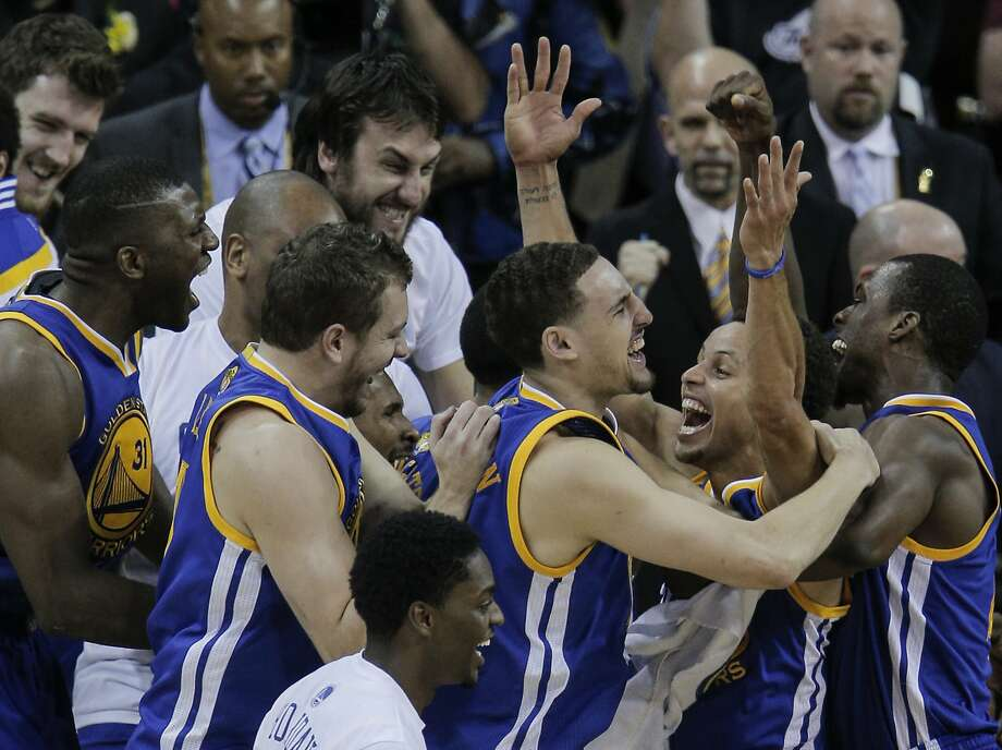 From left, the Warriors' Festus Ezeli, David Lee, Andrew Bogut (back- ground), Klay Thompson, Stephen Curry and Draymond Green savor the moment after clinching the NBA title in Cleveland in June. Photo: Carlos Avila Gonzalez, The Chronicle