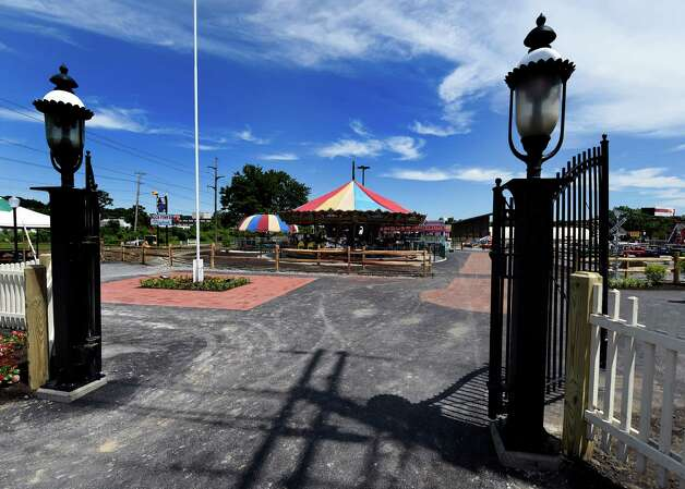 The main gates of the Huck Finn Playland are open for finishing touches today June 17, 2015 but will officially open  tomorrow in Albany, N.Y.      (Skip Dickstein/Times Union) Photo: SKIP DICKSTEIN / 00032078A