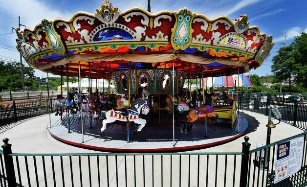 The antique carousel at the  Huck Finn Playland are receiving finishing touches June 17, 2015 and will officially open  tomorrow in Albany, N.Y.      (Skip Dickstein/Times Union) Photo: SKIP DICKSTEIN / 00032078A
