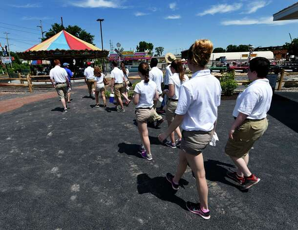 The staff of Huck Finn's Playland head out to ready the park today June 17, 2015 for the official opening tomorrow in Albany, N.Y.      (Skip Dickstein/Times Union) Photo: SKIP DICKSTEIN / 00032078A