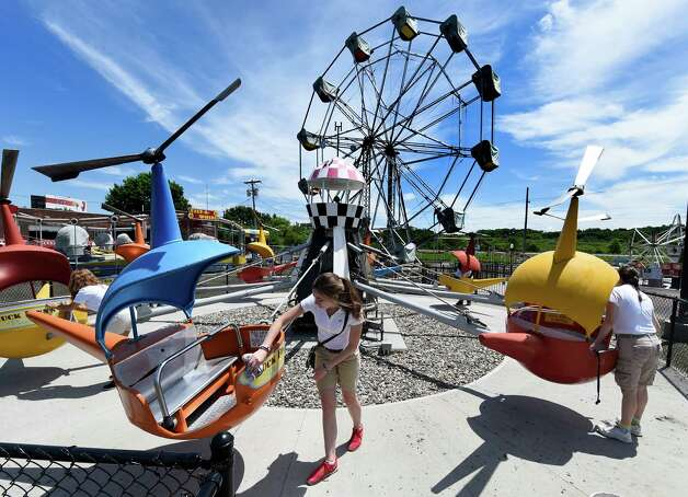 The staff of Huck Finn's Playland dust off some of the rides today June 17, 2015 for the official opening tomorrow in Albany, N.Y.      (Skip Dickstein/Times Union) Photo: SKIP DICKSTEIN / 00032078A