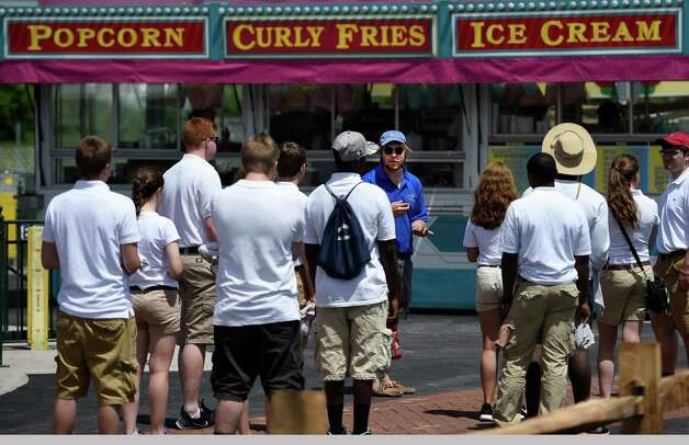 The staff of Huck Finn's Playland gets their working orders from ops director James Coover today June 17, 2015 in preparation for the official opening tomorrow in Albany, N.Y.      (Skip Dickstein/Times Union) Photo: SKIP DICKSTEIN / 00032078A