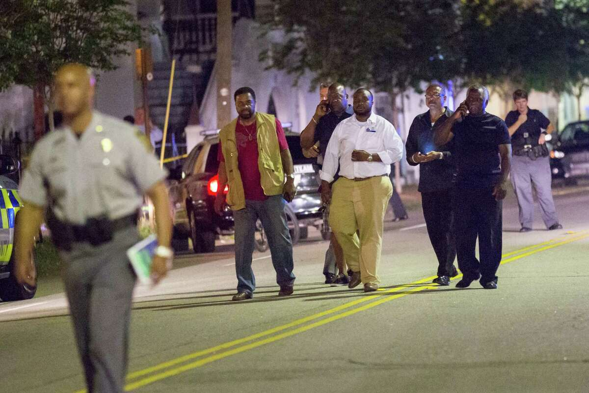 A group of local clergy return from the historic Mother Emanuel African Methodist Episcopal Church where a gunman opened fire on a prayer meeting killing nine people on Wednesday in Charleston, South Carolina. Police believe the attack is a hate crime and are searching for a young white man believed to be the only shooter.