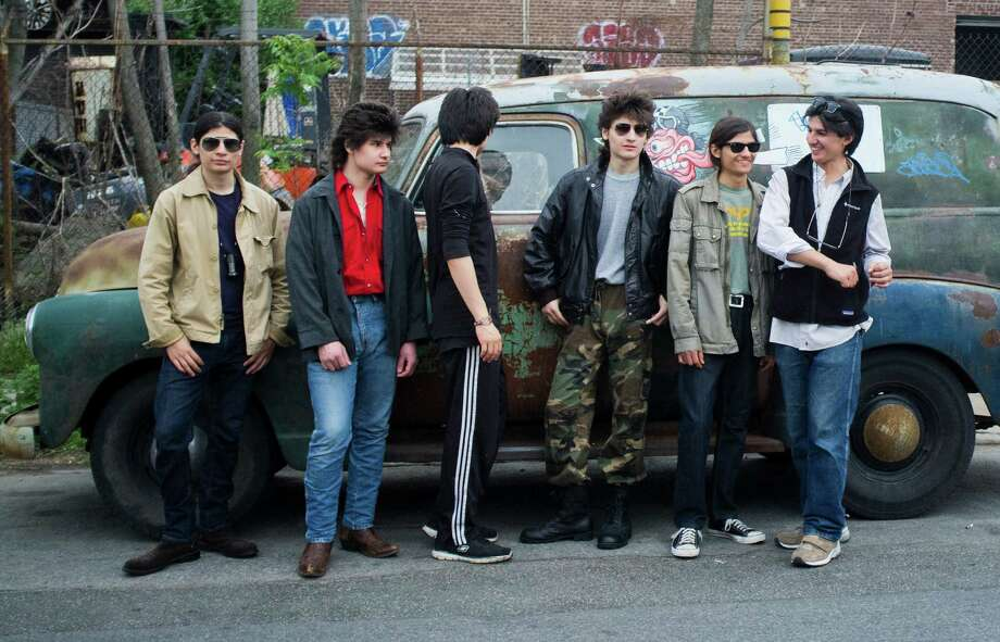 """The sibling subjects of """"The Wolfpack"""" have been locked up in their Manhattan apartment by a domineering father for much of their lives. The Argulos developed an intense bond with the movies that were the only window to the outside world. Photo: CHRISTIAN HANSEN, STR / NYTNS"""