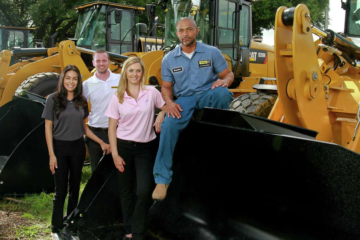 Melissa Miranda, from left, Matthew Mann, Jenna Cleaveland and Brandon Witkowski with a 926 Cat Wheel Loader in the Mustang Machinery Yard.