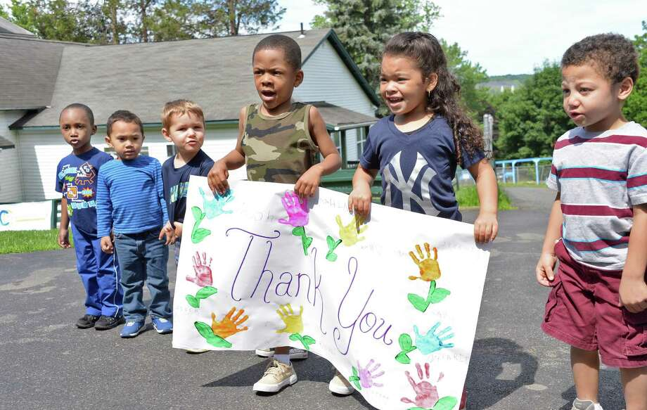 Preschoolers carry a giant thank you card during groundbreaking ceremonies for a new kitchen at Sunnyside Child Development Center Wednesday June 17, 2015 in Troy, NY.  (John Carl D'Annibale / Times Union) Photo: John Carl D'Annibale / 00032308A