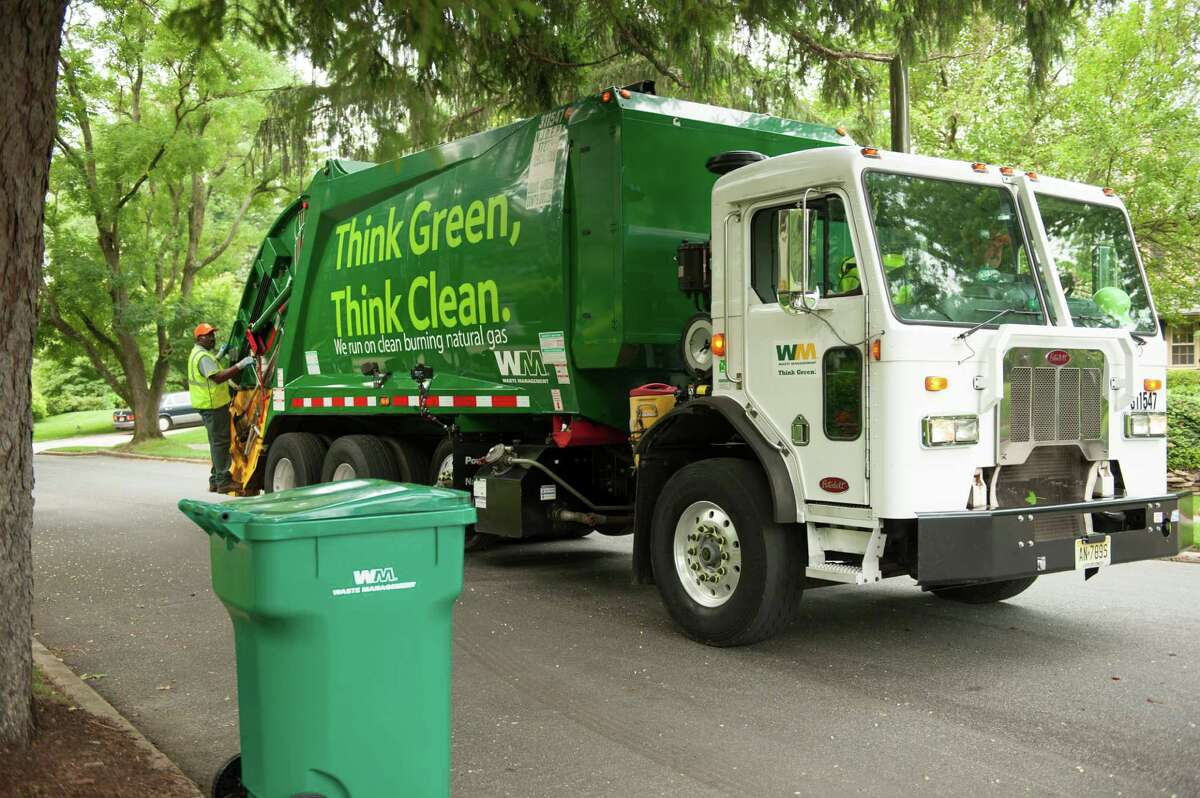 Waste Management trucks fueled by compressed natural gas (CNG) prepare for their morning pickups in the Camden, N.J. market in this file photo. The Houston-based waste hauler this week named its new CEO, longtime executive James C. Fish, Jr.