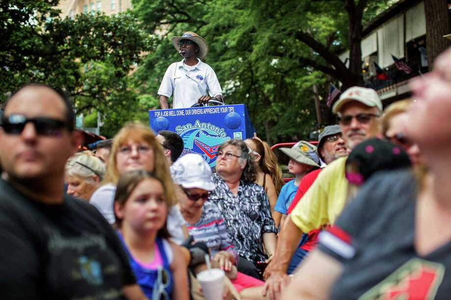 Ted Samuels, who refers to himself at T.O., gives a boat tour along the river walk in downtown San Antonio. Ray Whitehouse, Staff /San Antonio Express-News Photo: Ray Whitehouse, Staff / San Antonio Express-News / 2015 San Antonio Express-News