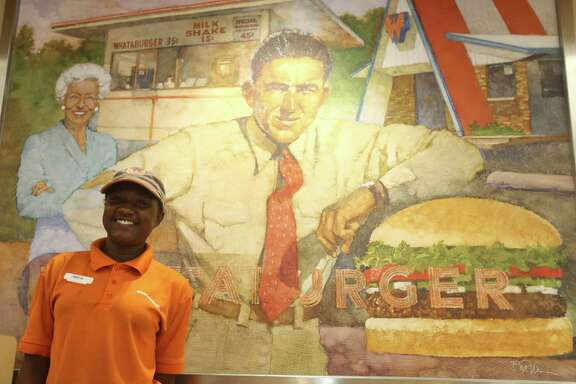 Amelia Demery stands before a retro fashioned painting of Whataburger at the Whataburger off Silber Road in Houston, Tx Thursday, June 4, 2015.