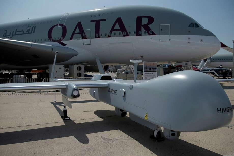 An Harfang Male UAS drone is displayed in front the Airbus A380 of Qatar Airways at the Paris Air Show, in Le Bourget airport, north of Paris, Wednesday, June 17, 2015.  Photo: Francois Mori, AP / AP