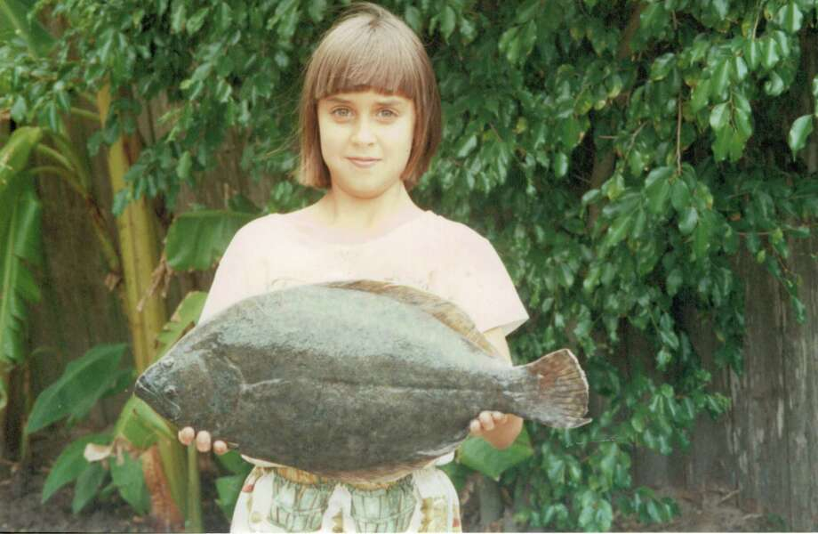 9-year-old Zifa Guerrero shows off the four-pound, 11-ounce flounder that earned her a $50,000 scholarship in the 1995 CCA Texas STAR tournament. Photo: Courtesy Photo