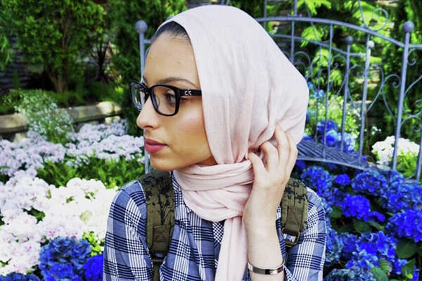 Noor Tagouri poses in front of hydrangeas at Muttart Conservatory in Edmonton, Canada. Illustrates TV-HIJABI